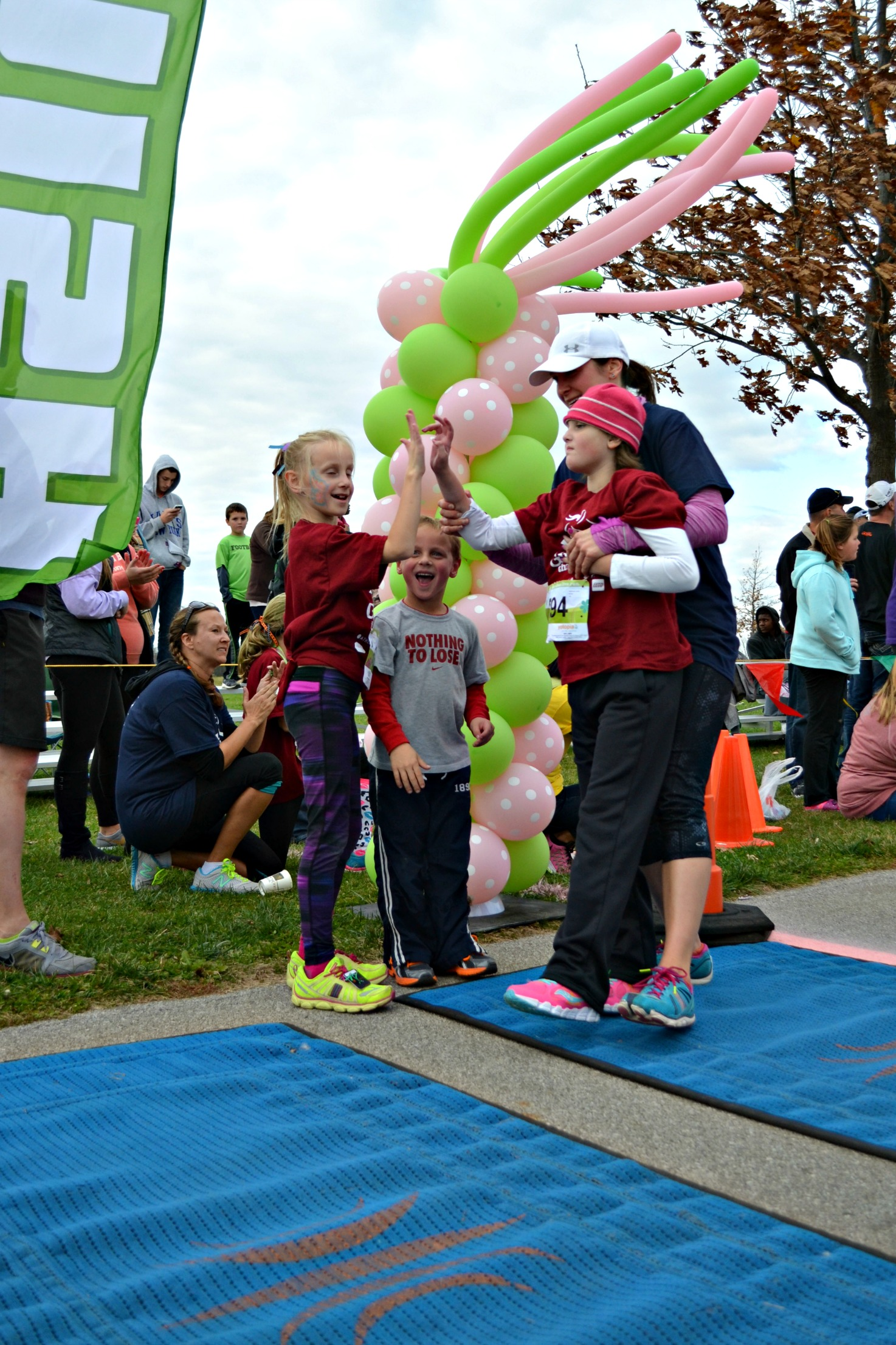 Anna and sister Averie high-five at finish line
